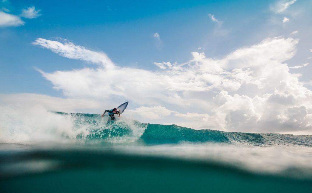 Un surfer membre de Global Sport Activists®